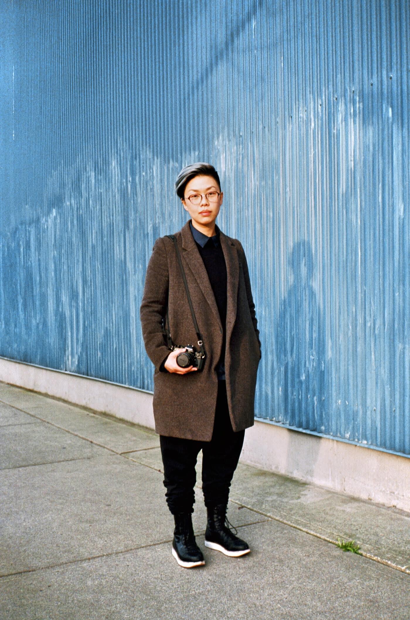 Jo Shin headshot - blue background